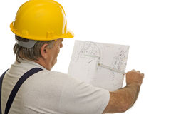 Construction worker with plan of an architect. For the planning of a house Royalty Free Stock Image