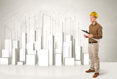 Construction worker planing with 3d buildings in background Royalty Free Stock Photography