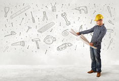 Construction worker planing with hand drawn tool icons Royalty Free Stock Photography