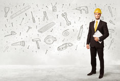 Construction worker planing with hand drawn tool icons Stock Photography