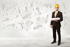 Construction worker planing with hand drawn tool icons Stock Images