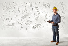 Construction worker planing with hand drawn tool icons Stock Photos