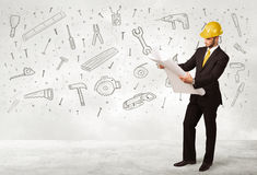 Construction worker planing with hand drawn tool icons Royalty Free Stock Image