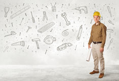 Construction worker planing with hand drawn tool icons Royalty Free Stock Images