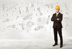 Construction worker planing with hand drawn tool icons Stock Photo
