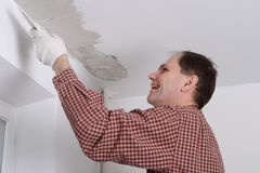 Plastering a ceiling Stock Image