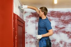 Construction worker plastering old apartment walls royalty free stock photo