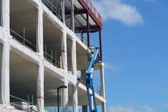 Construction worker on platform Stock Images