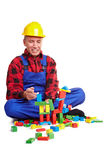 Construction worker playing Royalty Free Stock Photos