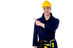 Construction worker pointing away Royalty Free Stock Image