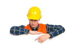 Construction worker pointing at banner. Stock Photos