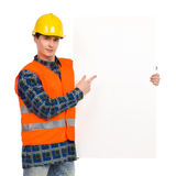 Construction worker pointing at banner. Royalty Free Stock Photos