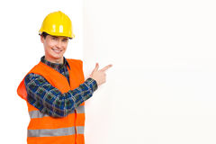 Construction worker pointing at banner. Stock Image