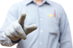 Construction worker pointing with finger. Ready for sample text Royalty Free Stock Image