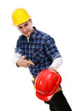 Construction worker pointing at a hardhat Royalty Free Stock Image