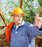 Construction Worker Pointing At Site Royalty Free Stock Photos