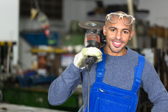 Construction worker posing with angle grinder Royalty Free Stock Photo