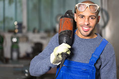 Construction worker posing with angle grinder Royalty Free Stock Photography