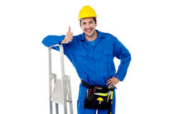 Construction worker posing with step ladder Royalty Free Stock Images