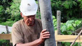 Construction worker pouring cement and concrete with pump tube stock footage