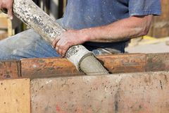 Construction worker pouring cement foundation. Horizontal Royalty Free Stock Image