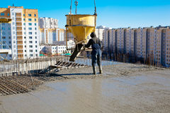 Construction Worker Pouring Concrete Stock Images
