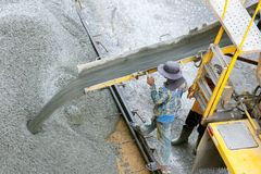 Construction worker pouring concrete from cement truck, people worker Royalty Free Stock Photo