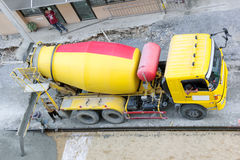 Construction worker pouring concrete from cement truck, people worker Stock Photography