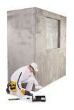 Construction worker pouring a primer in a paint tray Stock Photography