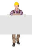 Construction worker presenting empty banner. Isolated on white background Royalty Free Stock Photography