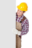 Construction worker presenting empty banner. Isolated on white background Stock Image