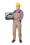 Construction worker presenting laptop Stock Photos