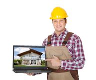 Construction worker presenting laptop Royalty Free Stock Image
