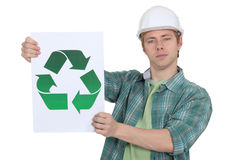 Construction worker promoting recycling. Stock Image