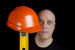 Construction worker with protection helmet and level Stock Images