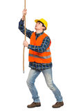 Construction worker pulling a rope. Full length studio shot isolated on white Royalty Free Stock Images