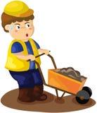 Construction worker pushing a wheelbarrow Royalty Free Stock Photography