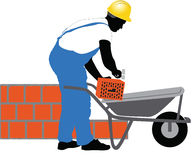 Construction worker puts a brick Royalty Free Stock Photo