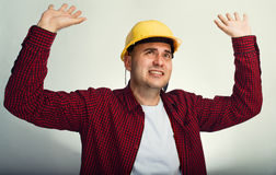 Construction worker with raised hands Royalty Free Stock Image