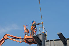 Construction worker on a raised platform 3 Stock Image