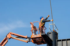 Construction worker on a raised platform 5 Royalty Free Stock Image