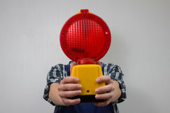 Construction worker with a red construction site-lamp Royalty Free Stock Image