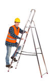 Construction worker in reflective clothing climbing a ladder. Royalty Free Stock Photo