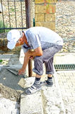 Construction worker renovating pavement Royalty Free Stock Photography