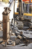 Construction Worker Repairing Road Surface With Jackhammer. Construction Worker Repairs Road Surface With Jackhammer Stock Image
