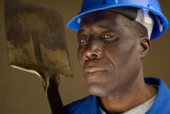 Construction Worker Resting Shovel on Shoulder Royalty Free Stock Images