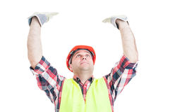 Construction worker rising up something heavy Royalty Free Stock Photos