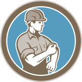 Construction Worker Rolling Up Sleeve Circle Retro Stock Photos
