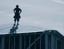 Construction worker on roof stock images