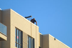 Construction worker on roof top concrete building Stock Images